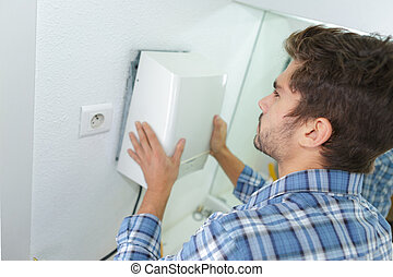 installation of hand-dryer in office