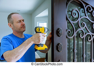 Installation of interior with a lock in the door leaf using an drill screwdriver,for holding screws