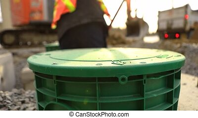 Installation of new septic tanks on site - Close up footage ...
