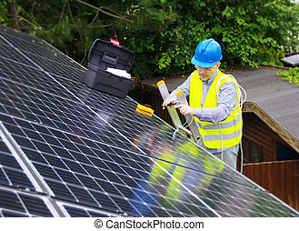 Installation of solar panels on the house roof