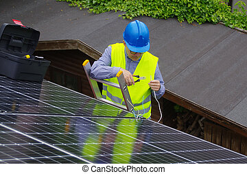 Installation of solar panels on the house roof - renewable energy