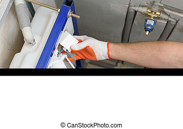 Installation of toilet siphon. - A worker is inserting the...