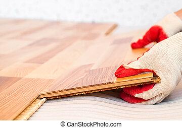 Installation of wooden floorboard