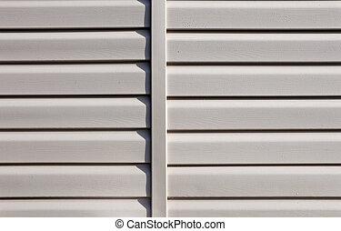Installation on facade of the house panels beige vinyl siding