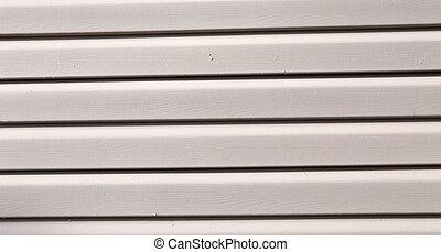 Installation on facade panels beige vinyl siding