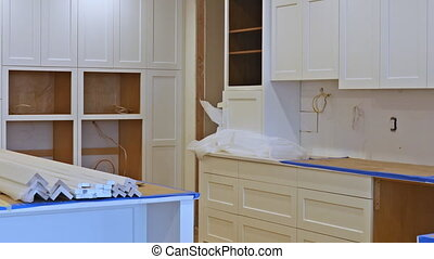Installing cabinets in a kitchen in the process of...