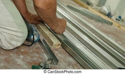 Installing drywall - Man installing plasterboard walls in...
