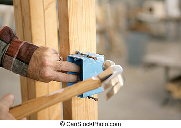 Installing Electrical Box - A closup of an electrician's ...