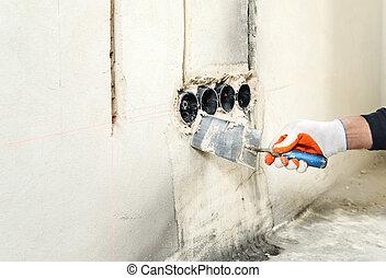 Installing electrical socket box.