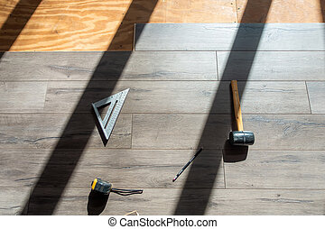 installing engineered laminated wood flooring and tools to use