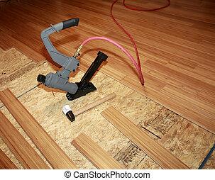 Installing hard-wood flooring - Installing of beautiful...