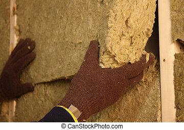 Installing Insulation Closeup - Closeup of a person...