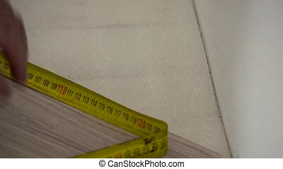 Installing laminate with roulette - Carpenter worker...