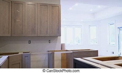 Installing new induction hob in modern kitchen kitchen ...