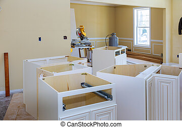 Installing new modern kitchen of installation base for island in center