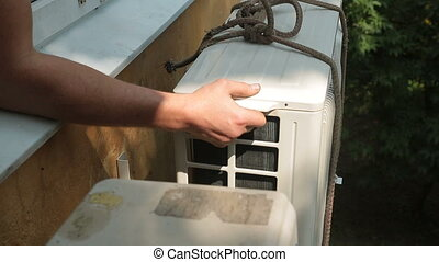 Installing of Air Conditioner - Man repairing air...