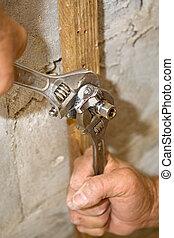 Installing Plumbing Valve - Closeup of plumber\\\'s hands...