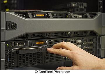 Installing server - A technician install a 2 unit rack ...