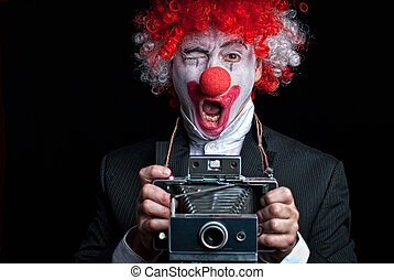 Instant camera clown - colorful clown with an instant camera...