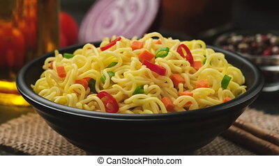 Instant noodles on black background, served with vegetables and herbs, spicy asian lunch, ProRes uncompressed