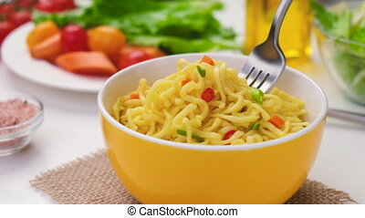 Instant noodles with fork, served with vegetables and herbs, spicy asian lunch, ProRes uncompressed