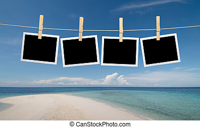 instant photos at the beach - blank instant photos hanging...