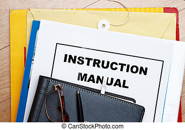 Instruction Manual abstract with manila envelop and diary