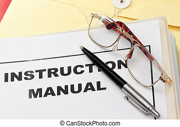 instruction manual user guide with pen and eyeglass