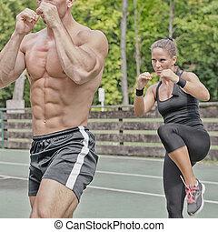 Instructor and female athlete on Tae Bo training