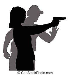 Instructor assisting woman aiming hand gun at firing range