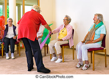 Instructor helping women with scarf exercises