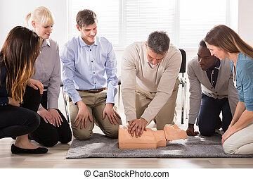 Instructor Performing Resuscitation Technique On Dummy