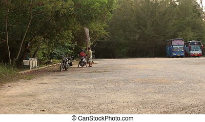 instructor talks with girl in helmet on scooter