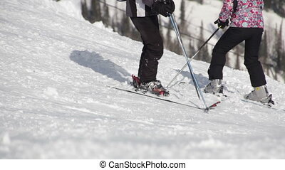 instructor teaches the skier to ride on a mountain top