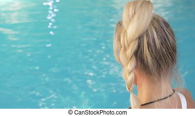 Instructor training women aqua gymnastic in swimming pool. -...