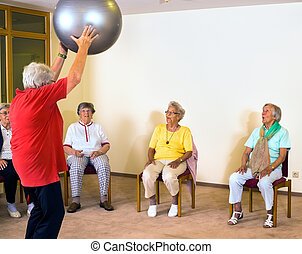 Instructor working with senior ladies in a gym