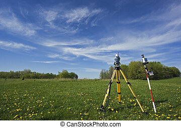 Instrument in the field - spring land surveying.