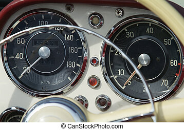 Dashboard and instrument of classic, cream coloured, German sportscar from the fifties.