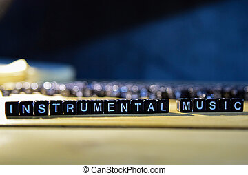 INSTRUMENTAL MUSIC concept wooden blocks on the table.