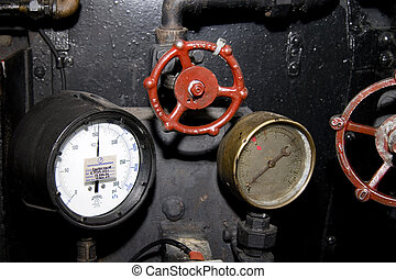 Instruments readings - Guages and valves in a steam engine.