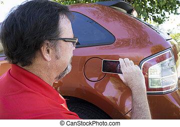 Insuarance Adjuster Taking Photos - Insurance adjuster...