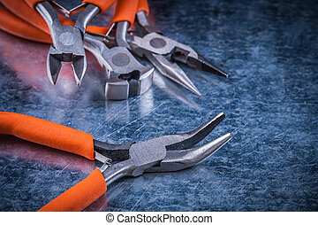 Insulated electric nippers gripping tongs with rubber handles electricity concept.