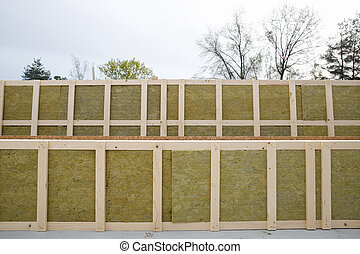 Insulated frames for prefabricated house with sky and trees