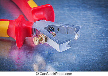 Insulated wire strippers on metallic background top view ...