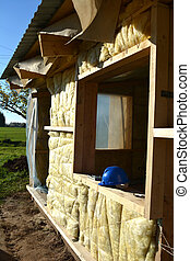 Insulating farm house wall with mineral rock wool