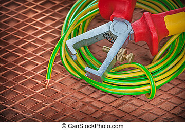 Insulation strippers electric wire on dielectric mat