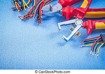 Insulation strippers set of electric wires cutting pliers on blu