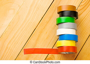 Insulation tape isolated on wooden background