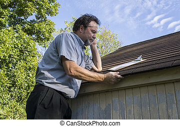 Insurance Adjuster Checking Roof For Hail Damage