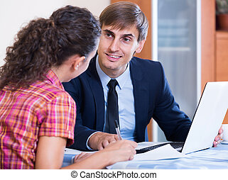 Insurance agent and customer discussing agreement terms